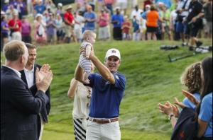 Kevin Streelman hoists Sophia, his newborn girl, in celebration after becoming the 2014 Travelers Champion.